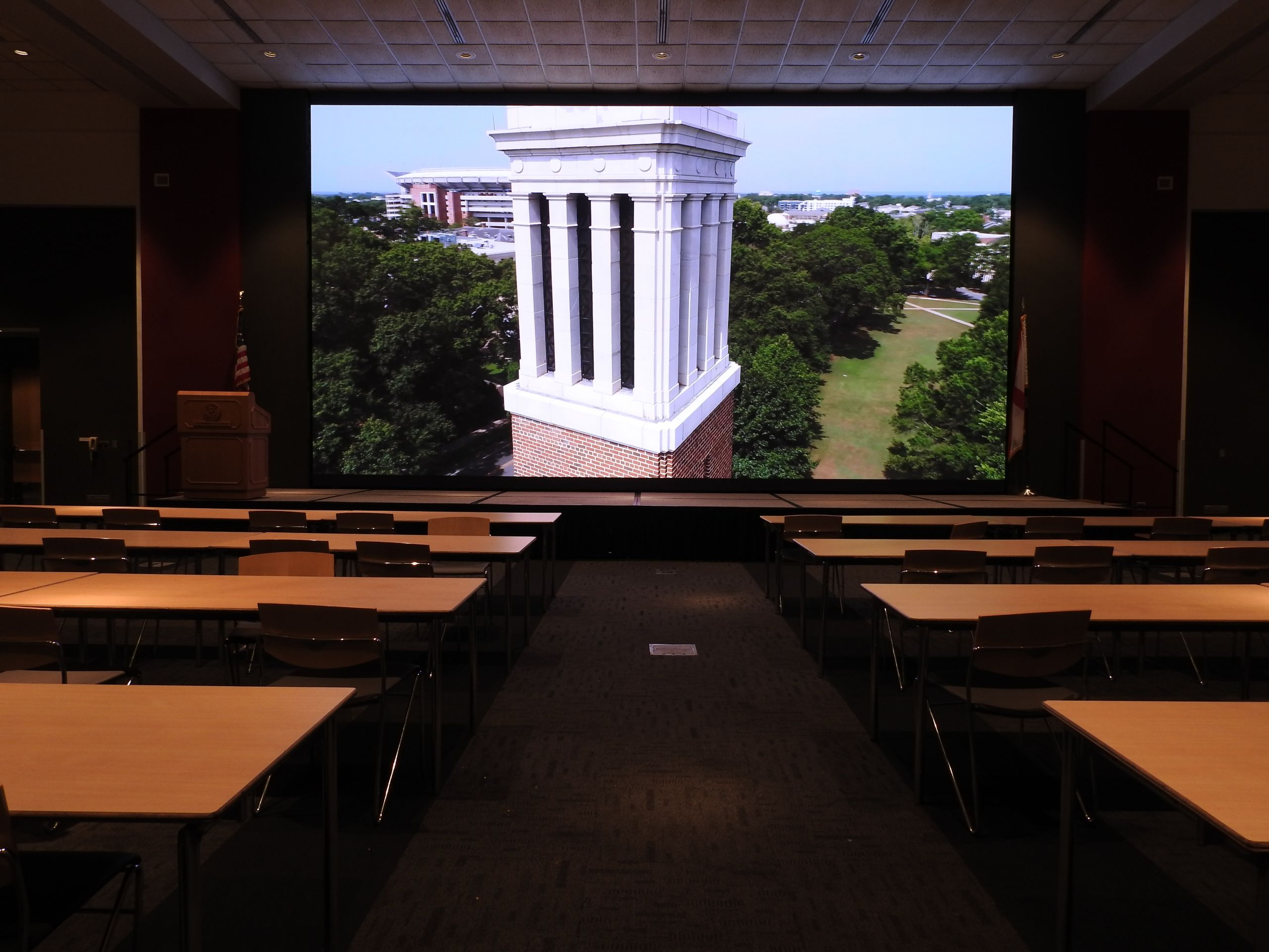 conference room with a screen depicting denny chimes