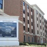 A Photo of Paty Residence Hall zoomed in on sign for Paty